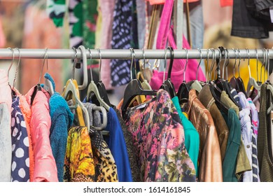 Vintage clothes hanging on clothes hanger on a rail