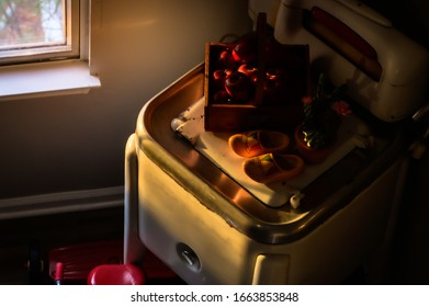 Vintage clothes washing machine as a decoration in the house with some warm light at the evening time.