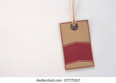 Vintage coarse carboard price label tag on white background