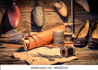Vintage cobbler workshop with brush and shoes
