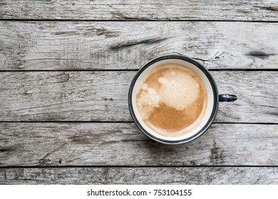 Vintage coffee cup over wooden background