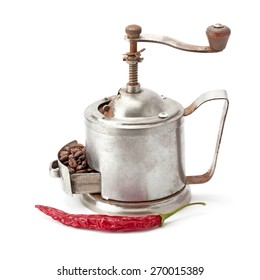 Vintage coffee grinder with coffee beans hot pepper