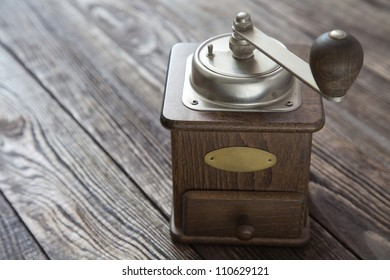 Vintage coffee grinder on a wooden table