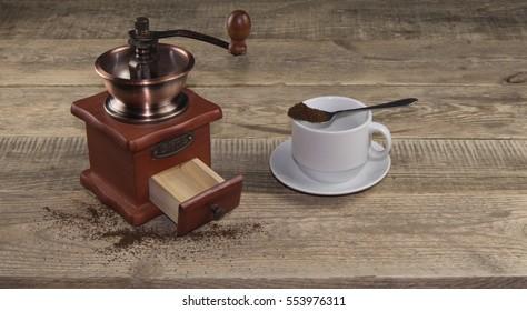 vintage coffee mill on wood background