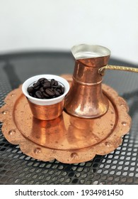 Vintage coffee pot. Coffee beans with retro style Copper pot.