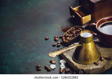 Vintage coffee pot and mill on dark grunge background with copy space