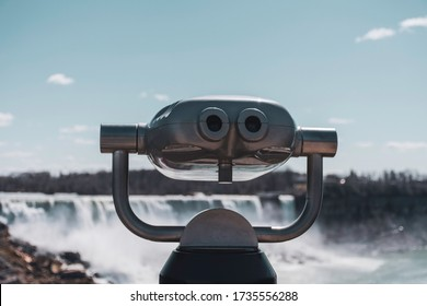 Vintage coin operated tourism binoculars are seen at Niagara Falls, an international travel destination.