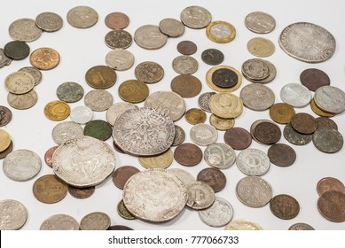 Vintage collectible coins on a white background.