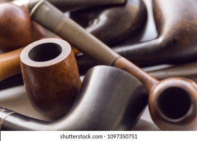 vintage collection of tobacco pipes