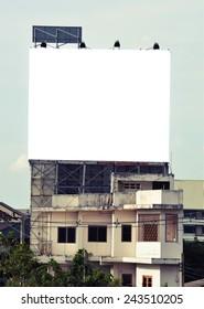 vintage color , blank advertisement billboard at  grunge old building