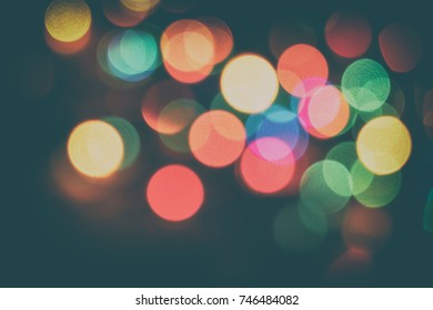 Vintage Color Bokeh Background. Defocused Abstract Soft Lights. Blurred Light Design Element. Festive Unfocused Backdrop. Elegant Tonned Retro Image