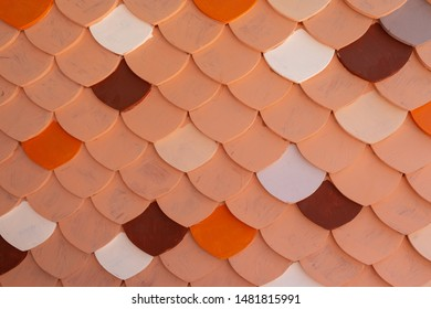 Vintage color of clay roof tiles is earthenware,Copper tiles wall cover pattern background texture.