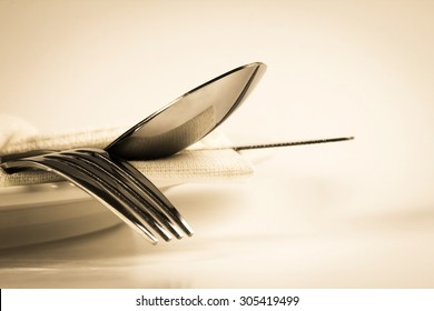 vintage color of close up dinning the silverware fork , spoon and knife with dish on white background and text space