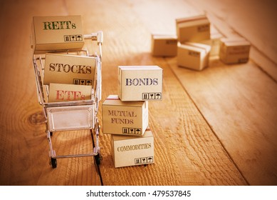 Vintage color style : Cartons of financial investment products in a shopping cart i.e REITs, stocks, ETFs, bonds, mutual funds, commodities. A concept of portfolio management with risk diversification