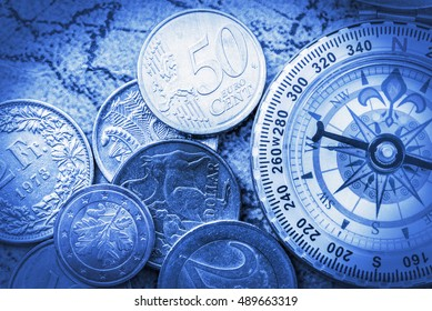 Vintage color style : Old compass and a pile of coins on an ancient map. An idea of managing money / assets that need a professional manager to guide or give a correct direction for gaining wealth.