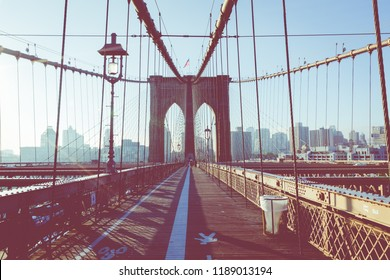 Vintage Color View of Brooklyn Bridge with Detail of Girders and Support Cables, Manhattan City Skyline at Sunrise, New York City, New York, USA