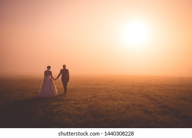 Vintage colored wedding photo, beautiful young couple at morning meadow