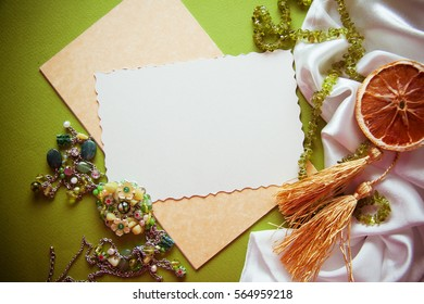 vintage colorful background with granny`s green necklace. Memories concept, photo with copy space