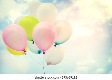 vintage colorful balloon with rainbow on blue sky concept of love in summer and valentine, wedding honeymoon