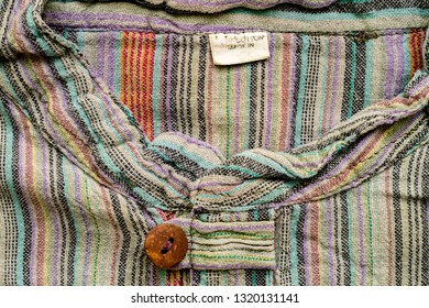 Vintage colorful flannel shirt neck with wooden button with a button loop