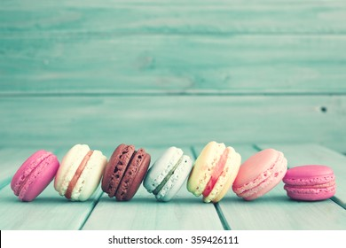 Vintage colorful macarons over turquoise wood