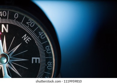Vintage compass in blue background.