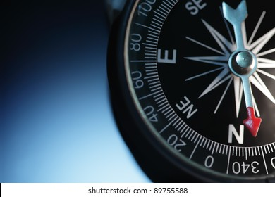 Vintage compass in blue background