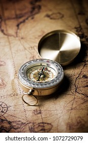 Vintage compass and old navigation map.