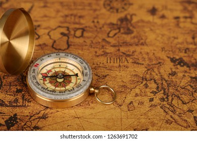 vintage  compass on old map - Explore the world-travel concept