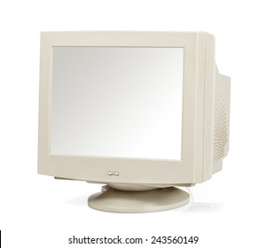 Vintage computer monitor with a blank screen viewed at an angle isolated on white