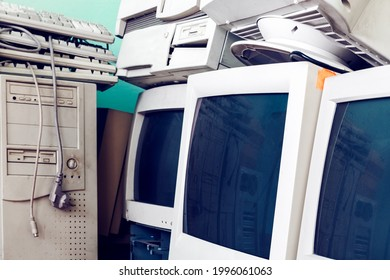 Vintage computers with CRT monitors . Out of use old computers . Pile of unused vintage electronic equipment