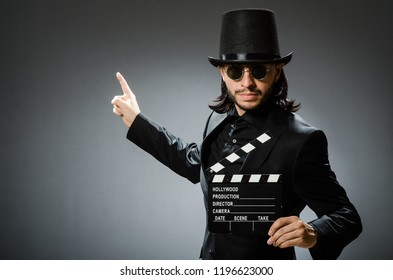 Vintage concept with man wearing black top hat