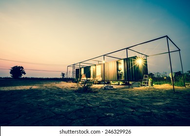 Vintage of container cabin home with twilight sky. Retro filter.