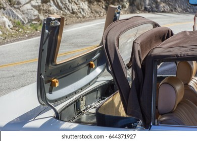 Vintage Convertible car with soft top closing/opening