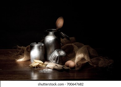 vintage cooking tools on a black background