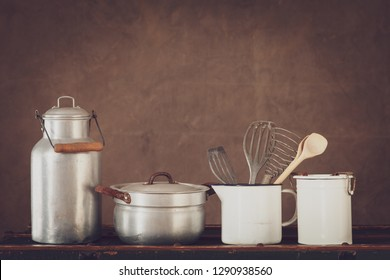 vintage cookware with  milk can, pot and milk pan with copy space