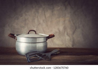 vintage cookware on wooden board with copy space
