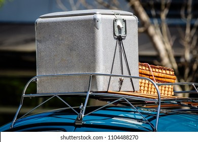 Vintage Cooler and Picnic Basket in the Car Rack on Roof of vehicle
