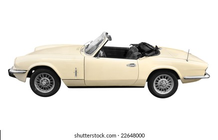 a vintage cream white British classic sports car from the 60s isolated on white background