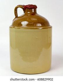 Vintage crock jug used to hold whiskey