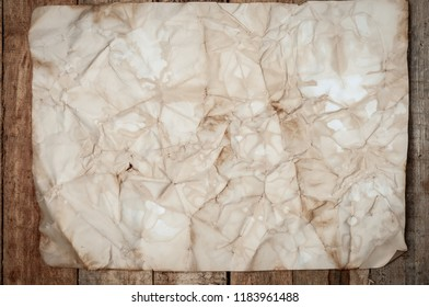 Vintage Crumpled paper texture on wooden table