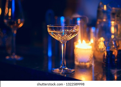 Vintage crystal glass on a blurred background. The atmosphere of