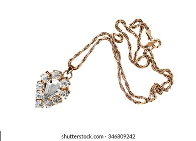 Vintage crystal pendant on golden chain isolated over white