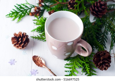 vintage Cup of hot cocoa or hot chocolate on wooden background decorated with spruce and pine cones, christmas concept