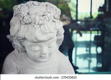 Vintage cupid sculpture