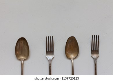 Vintage cutlery in a row. Top view