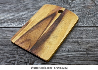 vintage cutting board with space for text on old wooden background