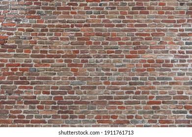 Vintage damaged old bricks wall