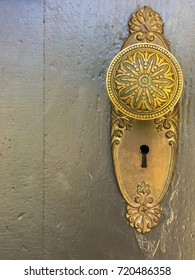 Vintage decorative gold door knob and lock.