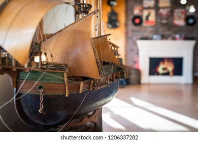 Vintage decorative sailboat made of wood in interior of home
